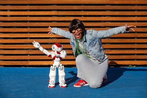 INNER WEST COURIER/AAP MC Mirrah with Ruby the robot at The Connection in Rhodes, NSW. Thursday 6th June 2019. Mirrah will join this year's Human Robot Friendship Ball as part of Vivid Live. (AAP IMAGE/Jordan Shields)